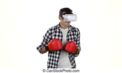 Man plays in a box with glasses of virtual reality, wireless...