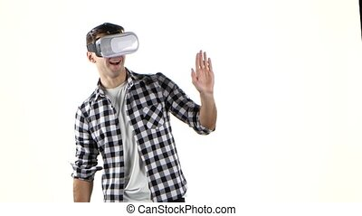 First looks at virtual reality glasses. Man waved his hand -...