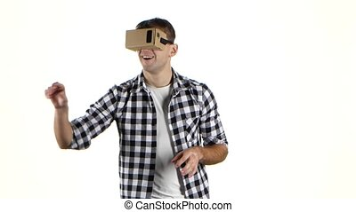 Cardboard of vr glasses. Man surprised by what he saw -...
