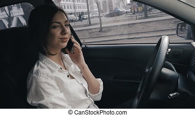Close up of businesswoman in the car making a phone call