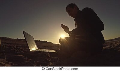 businessman man freelancer working behind sitting on beach...
