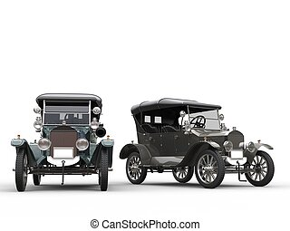 Restored vintage cars in metallic grey and blue