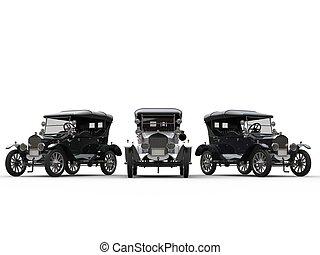 Three restored vintage cars