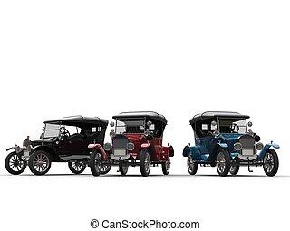 Black, red and blue restored vintage cars - studio shot