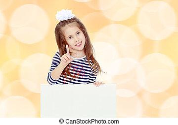 Little girl in a striped dress.