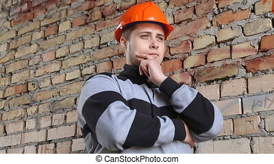 Engineer builder thinks about the object - Engineer develops...