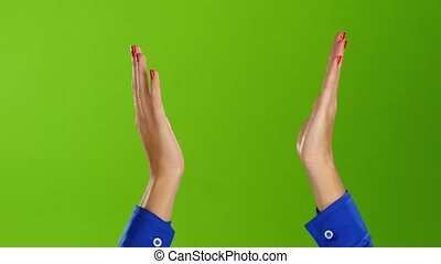 Female hands applauding straight wrists. Green screen studio...