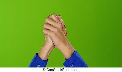 Green screen studio. Girl crosses her handbreadth of two...