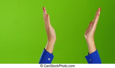 Green screen studio. Female hands applauding straight wrists...
