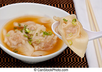 Wonton Soup - Spoon with won-ton over bowl of won-ton soup...