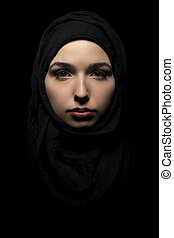 Portrait of Confident Woman Wearing a Black Hijab - Proud...
