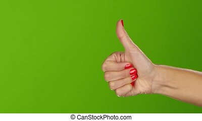 Greeen screen. Thumb up girl shows twice per frame, closeup...
