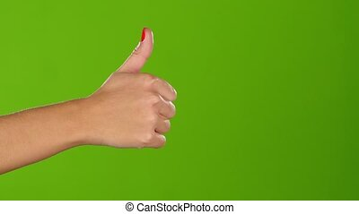 Thumb up girl shows twice per frame. Greeen screen. Closeup...