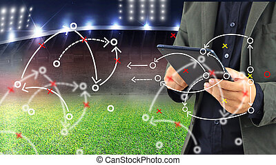 Football manager planning tactic with soccer field and...