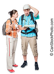 young couple can not agree on the travel route on a white...
