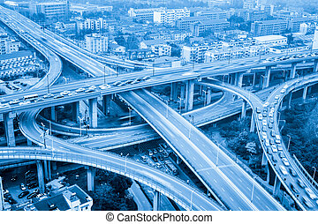 city highway interchange closeup ,motion blur with blue tone