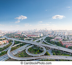 city highway interchange with blue sky, aerial view of...