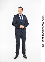 Smiling handsome businessman looking at camera on white