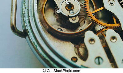 Old vintage clock mechanism working, closeup shot with soft focus