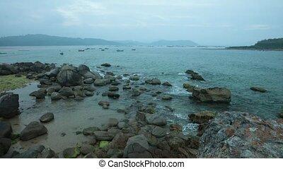 Ocean Scene Vietnam With Sound - A rocky coastline fishing...