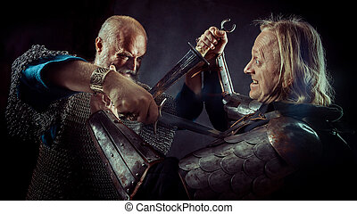 Dagger fight between two medieval knights on the dark...