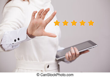 Five star rating or ranking, benchmarking concept. Woman...