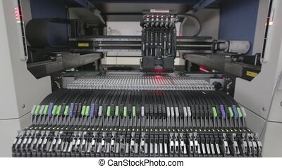 Automated Electronic circuit board production. Machine...