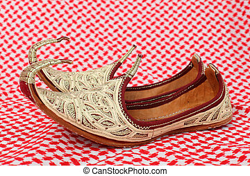 Traditional oriental shoes over arabic cloth