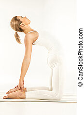 Woman standing in yoga pose - Woman practicing yoga standing...