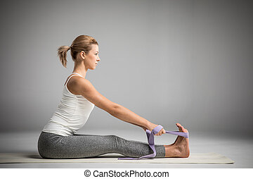 Athletic woman stretching - Side view of athletic woman...