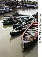 Boats in Jakarta slum - Boats in a canal of Jakarta slum,...
