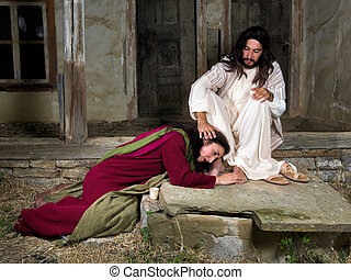 Mary Magdalene crying of shame and anointing Jesus' feet -...