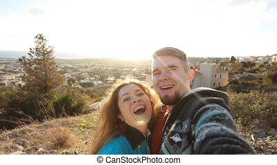 Traveling couple making selfie - Happy traveling couple...