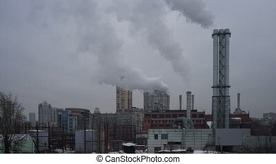 Thermal power plant . Industrial smoke from the pipes....