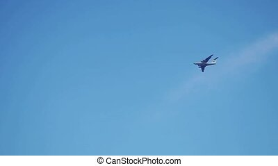 Airplane flies overhead in the blue sky in Slow Motion....