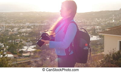 Woman is a professional photographer with dslr camera,...