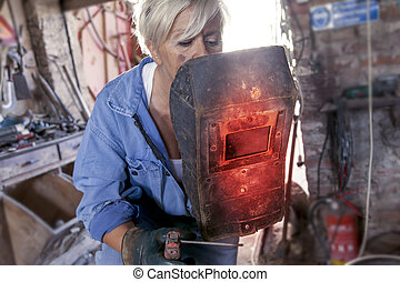 beautiful lady at work in his old workshop