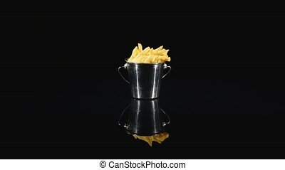 French fries on a black background.