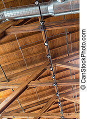 Rafters and Ductwork - Ductwork and lights below a natural...