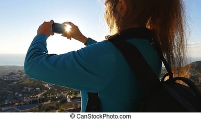 Woman taking photo with smart phone. Travel concept - Woman...