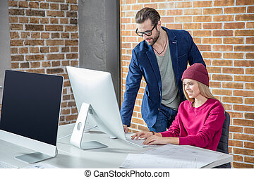 Man and woman working on computer