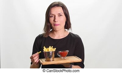 a young woman with fast food potatos