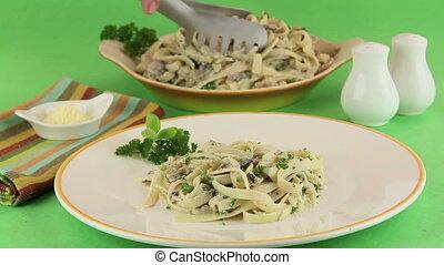 Fettucini Carbonara - Fettucini carbonara dished out on to a...