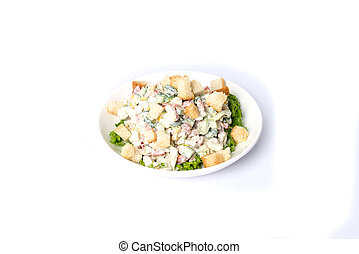 Ceasar salad served in the plate