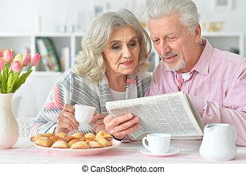 Elderly couple having breakfast - Portrait of an elderly...