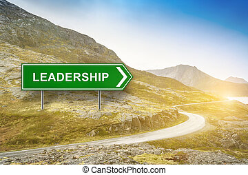 leadership words on green road sign with the curve road