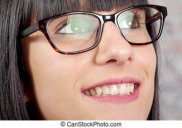 close-up of a woman eye with glasses