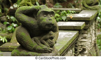 Statue of mythical animal. Mossy sculpture in Monkey forest....