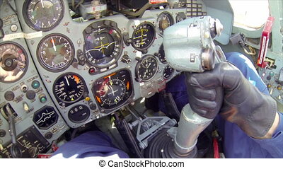The fighter dashboard and pilot hand operating military aircraft by side stick