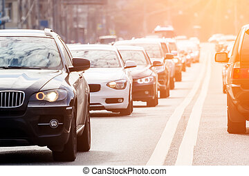 Traffic on the road with evening sun - Zoom view of the...